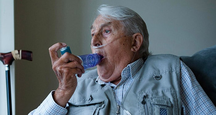 Elderly gentleman using an OptiChamber Diamond spacer while wearing a nasal canula to control flare up of COPD symptoms
