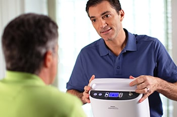 A COPD Patient being trained how to maintain the Philips SimplyGo Portable oxygen concentrator