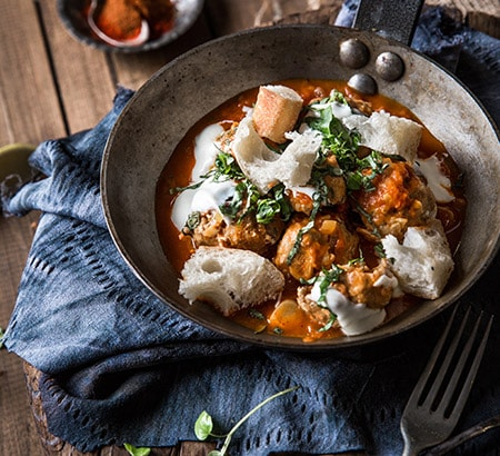 Roasted chicken meatballs with spiced tomato sauce, basil, yogurt & bread